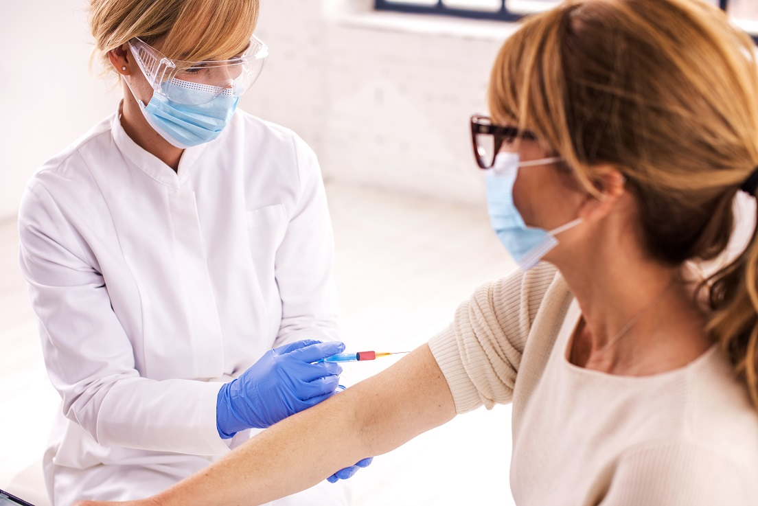 Woman getting vaccinated in hospital