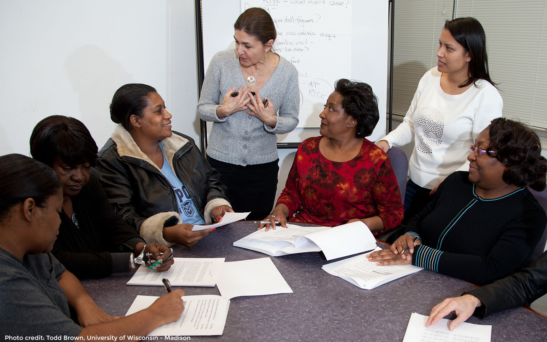 Woman discussing a topic with a diverse group