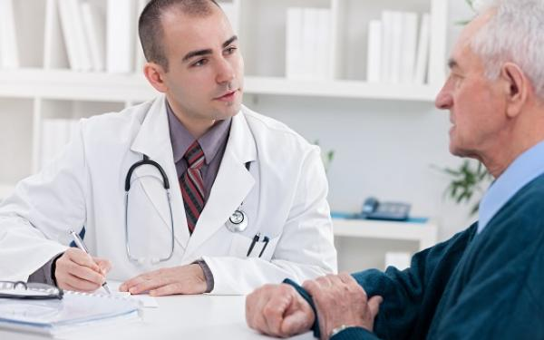 Doctor talking to older man